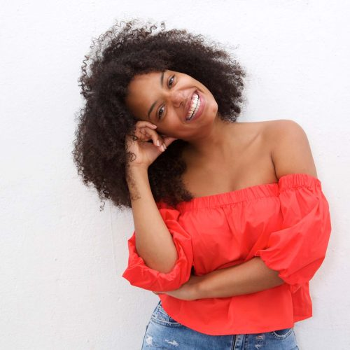 happy-african-american-woman-leaning-with-head-on-WXKZ6HD.jpg